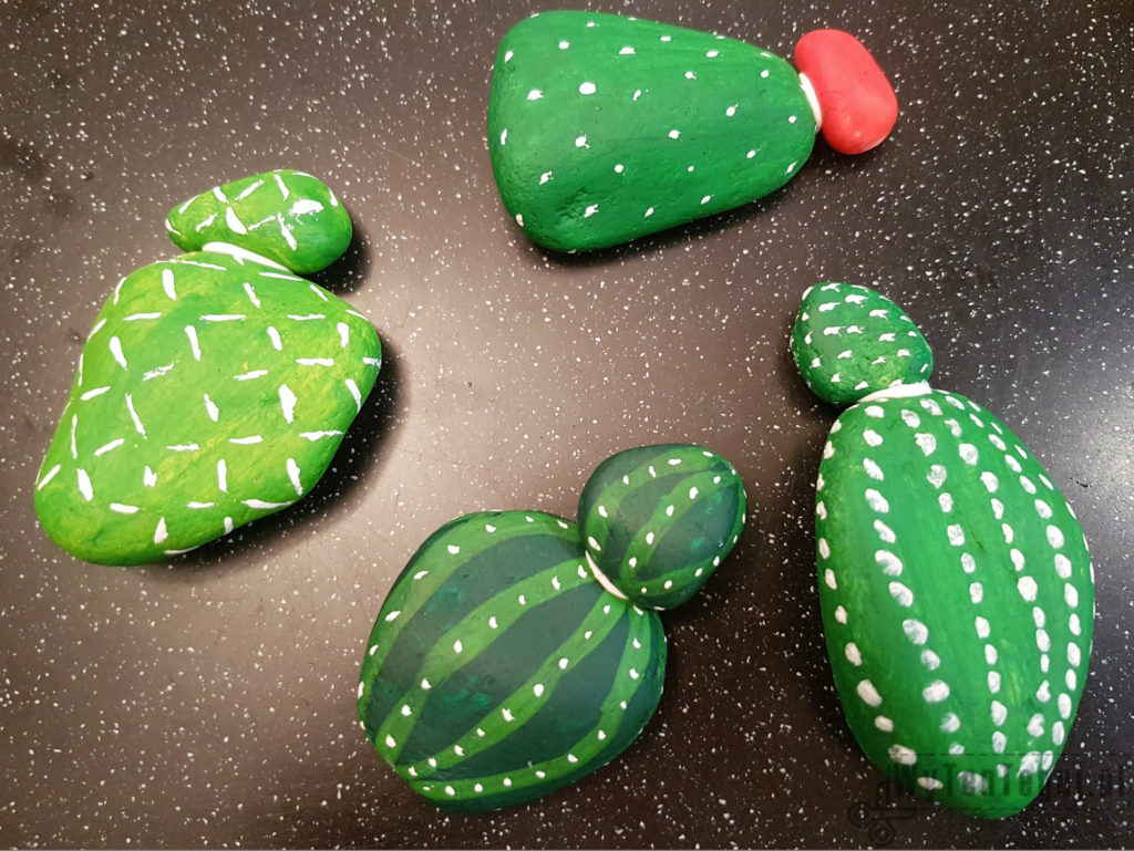 Painted rock cacti in progress