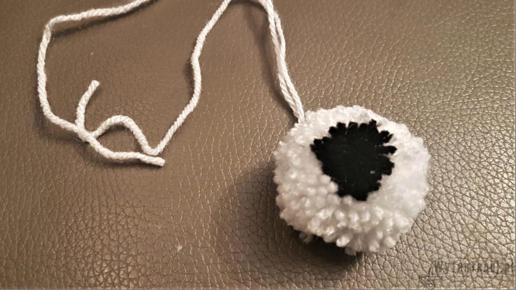White and black pom pom