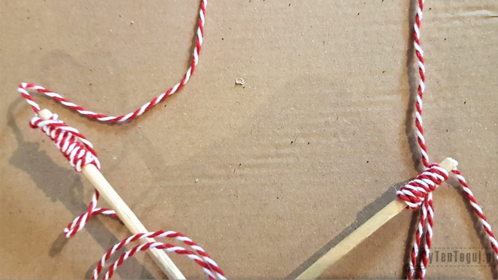 Attaching string with wooden balls