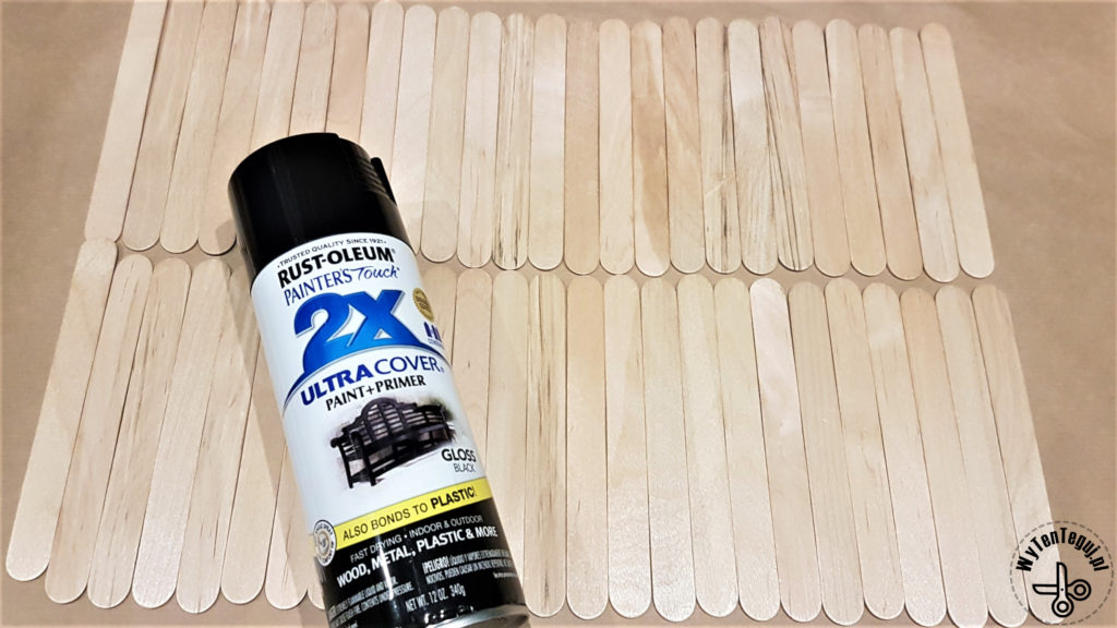 Preparing to paint popsicle sticks