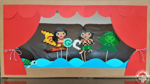 Cardboard theater with perler beads actors