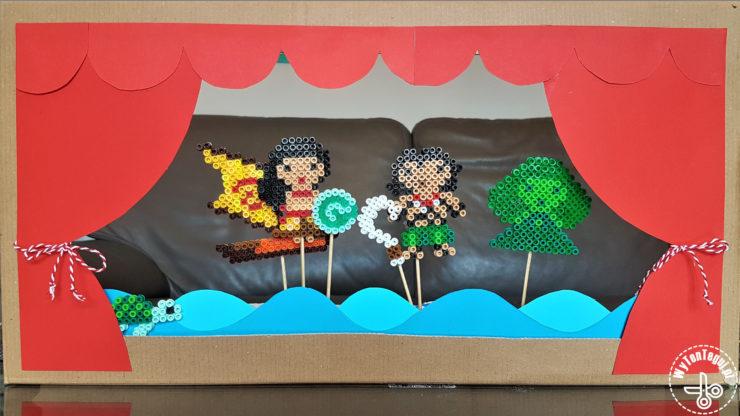 Cardboard theater with perler beads actors