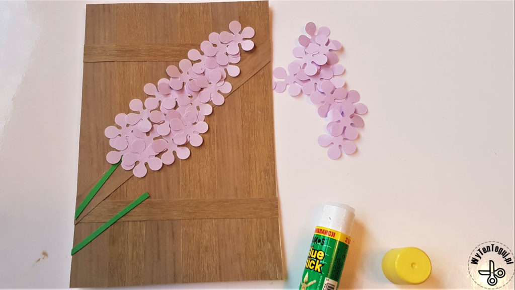 Gluing the lilac flower petals