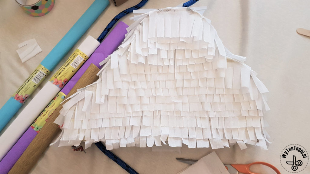 Decorating the cloud pinata with tissue paper