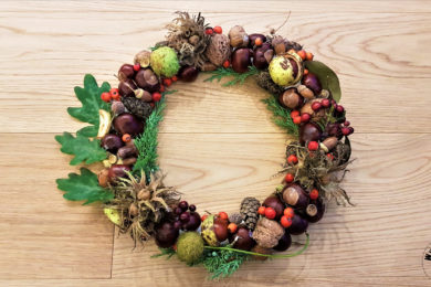 Autumn wreath with chestnuts, pine cones, acorns and nuts