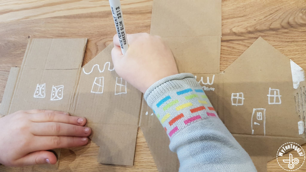 Decorating the box with white marker