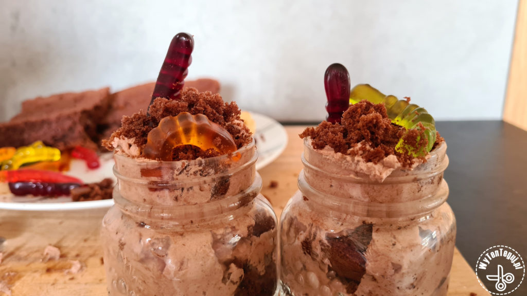 Dirt and worms dessert in a jar