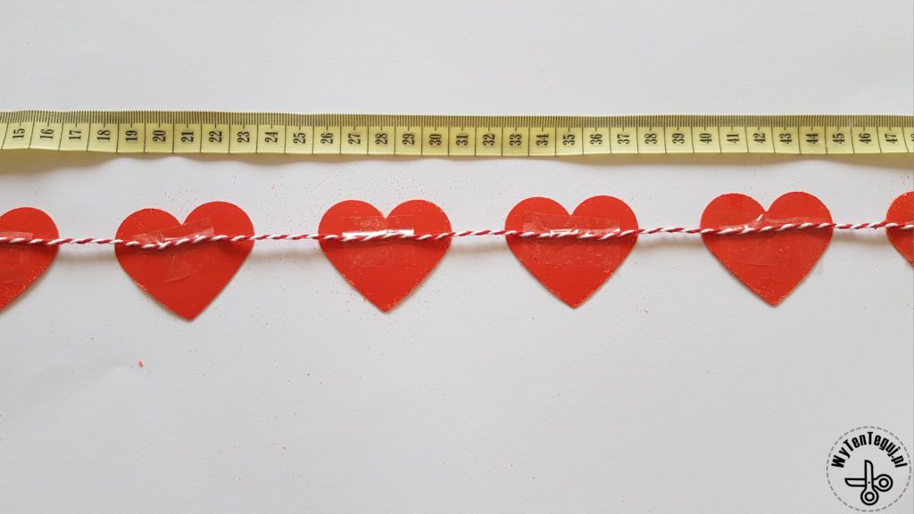 Attaching hearts to the string
