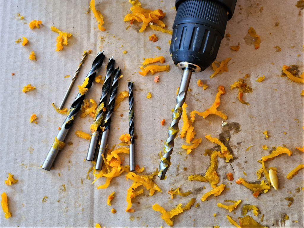 Use drill bits of different sizes to make a pumpkin lantern
